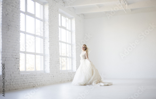 e6775d6cbfa bride run and dance in her wedding dress in big white room with big windows