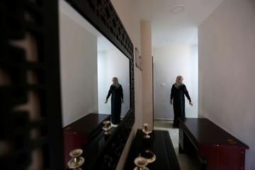 Bayan Samara walks at her home in Amman