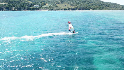 Photo sur Aluminium Dauphins Aerial drone bird's eye view photo of competition surfers in tropical wavy clear waters