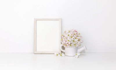 White wooden vertical frame mockup with flowers