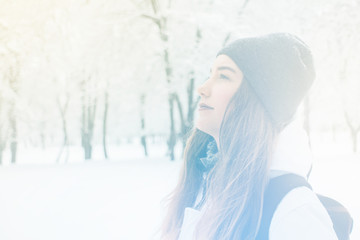 Portrait of happy cute girl traveling along snowy mountains, Light toning