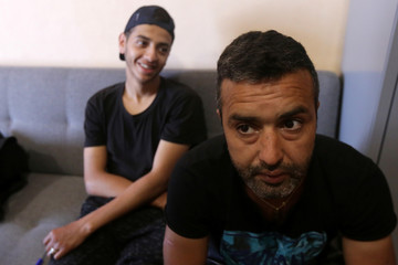 Hichem Boussadia (R), 29, looks on at a Border Police station in Shkodra