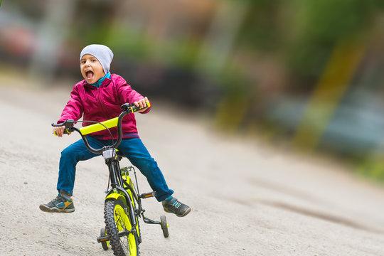 boy on bike with blurred background