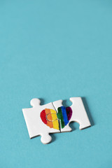 puzzle pieces forming a rainbow heart