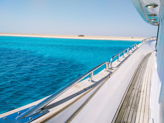 Amazing view on the tropical Island with white sand from the side of the yacht. Travel and Vacation concept