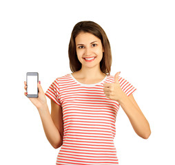 Pretty smiling woman showing a blank vertical smart phone screen and thumb up. emotional girl isolated on white background