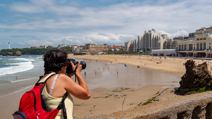 female photographer taking a photograph of the Biarritz city