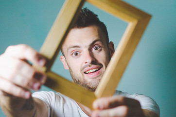 Bearded man with a wooden frame