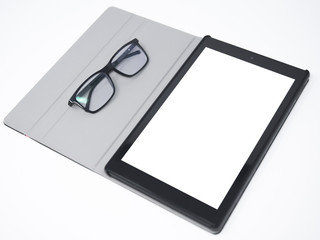 Tablet with blank screen isolated on a white surface and glasses laying on its side cover