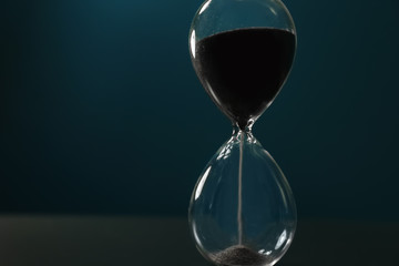 Crystal hourglass on color background. Time management concept