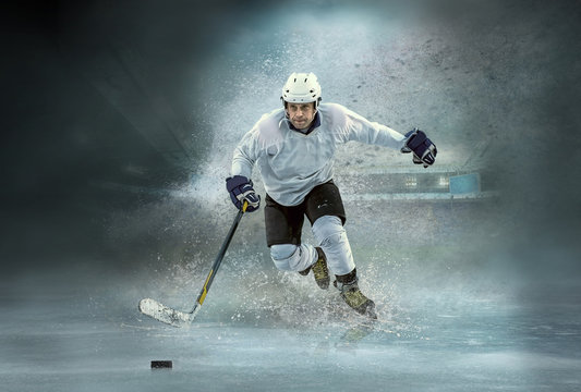 Caucasian ice hockey Players in dynamic action in a professional