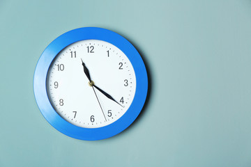 Modern clock on color wall. Time management concept