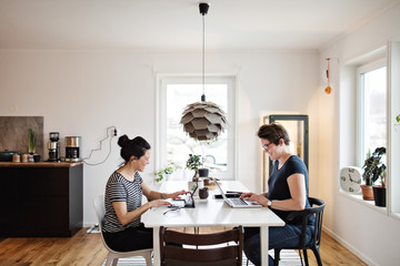 Women working on laptops at home