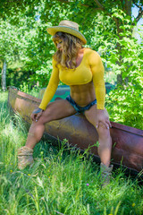 Fit bodybuilder woman posing on the nature. Sexy model portrait with perfect body. Concept oа sport woman life
