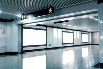 Empty billboards in subway stations