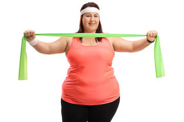 Overweight woman working out with a rubber band
