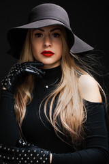 Picture of young blonde in hat ,gloves