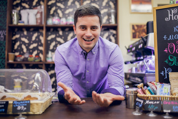 Photo of smiling male barista