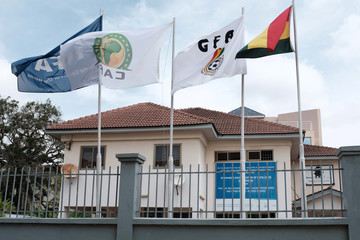 Flags flutter next to the premises of Ghana Football Association in Accra