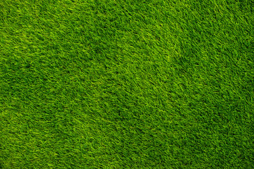 Background green grass top view. Artificial grass or lawn.