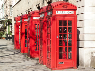 Traditional red cast iron telephone boxes in London