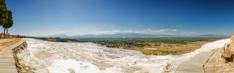 Sonny panoramic view of natural travertine pools and terraces in Pamukkale, Denizli province, Turkey.