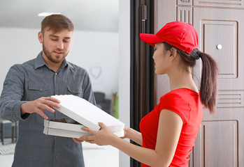 Young woman delivering food to client at doorway