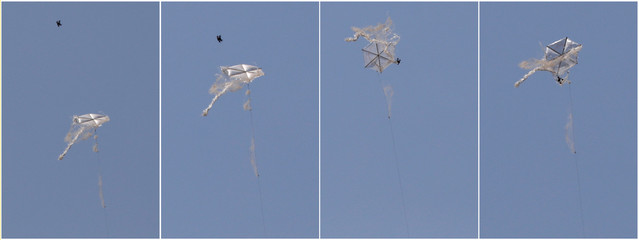 A combination picture shows an Israeli drone intercepting a Palestinian kite in an area where kites and balloons have caused blazes, on the Israeli side of the border between Israel and the Gaza Strip