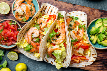 Shrimps tacos with salsa, vegetables and avocado. Mexican food Wall mural