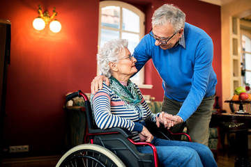 Senior couple in love, senior man take care of his wife