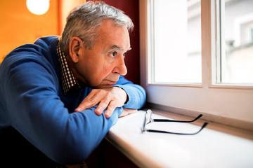 Sad depression man, senior forgot by family