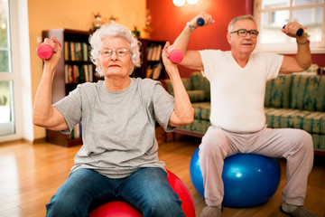 Senior couple at nursing home working out