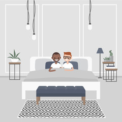 Modern bedroom interior. Couple of young adults lying in the double bed. Homosexual relationships. Gay partners. LGBTQ. Scandinavian design.