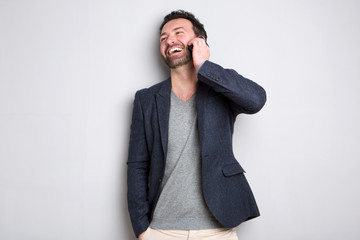 man laughing and talking on cellphone