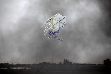 A kite flies over the border in an area where kites and balloons have caused blazes, between Israel and the Gaza strip