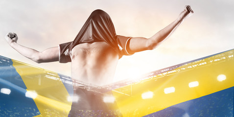 Sweden national team. Double exposure photo of stadium and soccer or football player celebrating goal with his jersey on head