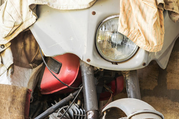 View of a fragment of an old motorcycle in the garage