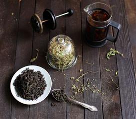 black tea welding on a platter on a dark wooden background