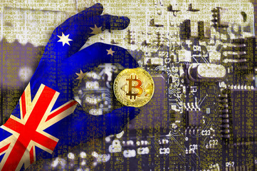 Bitcoin crypto currency Australia flag Binary code Golden Coin of Bitcoin in the Australian flag hand between two fingers shows OK sign on a chip background with matrix effect