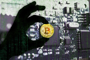 Bitcoin crypto currency Black hand shadow Binary code Golden Coin of Bitcoin in the black hand between two fingers shows OK sign on a chip background with matrix effect