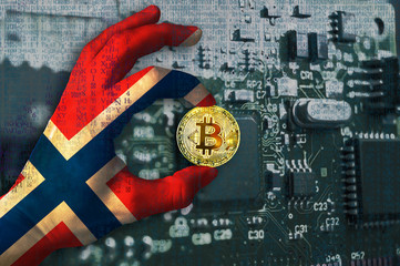 Bitcoin crypto currency Norway flag Binary code Golden Coin of Bitcoin in the Norwegian flag hand between two fingers shows OK sign on a chip background with matrix effect