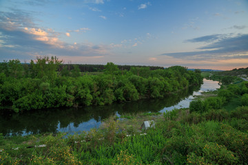 Foto op Aluminium Rivier Into the distance is a highway between the river and the chalk hills at sunset on a spring evening. Alekseevka, Koltunovka, Belgorod region, Russia.
