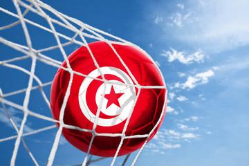 Fussball mit tunesischer Flagge
