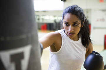 Woman boxer in gym