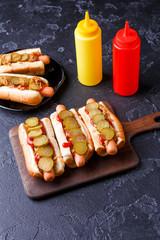Photo on top of hotdogs on cutting board