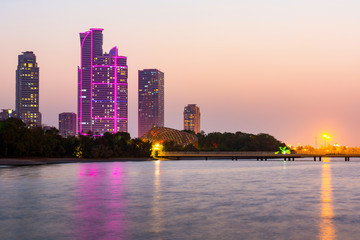 Sharjah butterfly island and hight buildings at dusk
