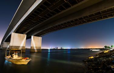 NIght view of Ras al Khaimah city bellow bridge