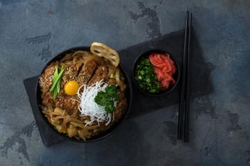 Rice bowl topped with fried pork cutlet Katsudon, tonkatsu donburi, japanese cuisine