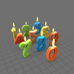 Numbered birthday candles lit
