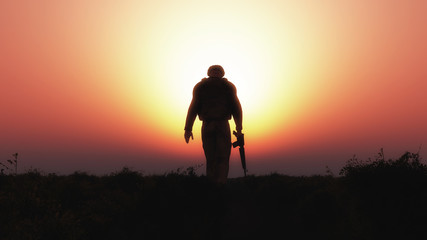 3D soldier walking against a sunset sky